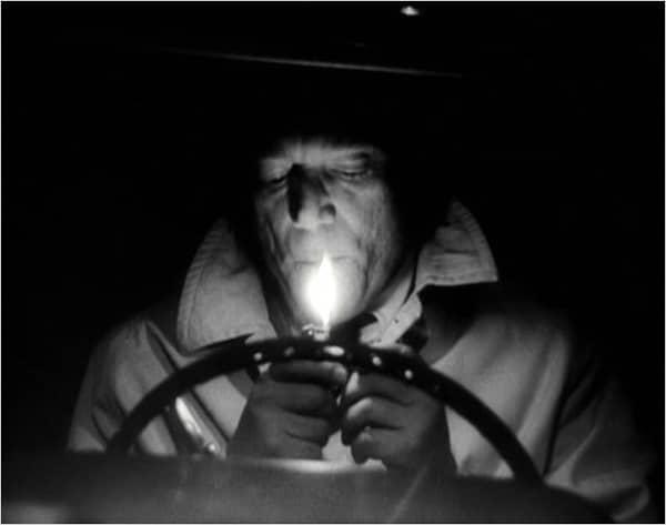 Eddie Constantine dans Alphaville de JL Godard in Voyage dans le cinéma français de Bertrand Tavernier